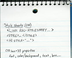 The top half of a loose-leaf spiral-bound notebook.  The page contains some simple notes about CSS, including the approximate number of properties and ways to associate CSS with HTML.