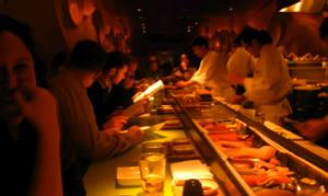 A view of the sushi bar from our seats, with Morimoto and his sushi staff slicing away