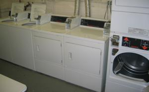A pair of top-loading washing machines sit to the far left, a pair of front-loaders sit in the middle, and a stacked pair of front-loading dryers can be seen on the right.  They actually don't look like they're any different than normal washing machines.
