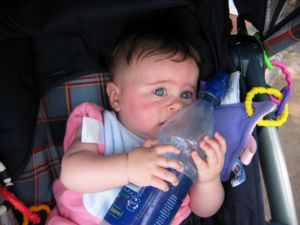 A photograph of six-month-old Carolyn clutching a water bottle to herself as if it were the most precious thing on Earth-- which, at that moment, it probably was.
