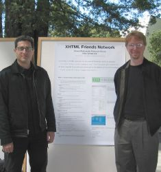 Tantek Çelik and Eric Meyer flank a conference poster presenting XFN.