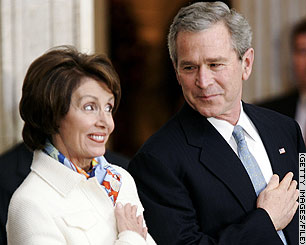 A picture of Nancy Pelosi and George W. Bush, bearing facial expressions I'm not sure can be described.